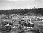 Innu men poling their canoes up Kaku-shipu (rivi�re Coxipi) end route to Sandwich Bay, Labrador 1920. Photo William Brooks Cabot, courtesy the Smithsonian Institution.