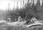 A birch bark canoe on the beach by an Innu camp near Sheshatshiu, Labrador,1891 (photo Rupert Baxter, Labrador Institute collection)