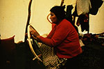 Nishet Penashue lacing snowshoes at her camp in the Akamiupishku region in the fall of 1977. Photo Nigel Markham. Courtesy Innu Nation.